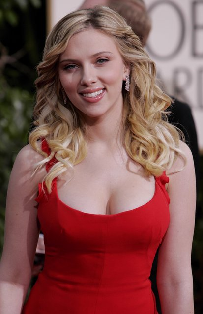 "Scarlett Johansson, nominated for best supporting actress for her work in ""Match Point"", arrives for the Golden Globe Awards on  Jan. 16, 2006, in Beverly Hills, Calif. Actress Scarlett Johansson was named Sexiest Woman Alive in 2006 and 2013. (Photo by Kevork Djansezian/AP Photo)"