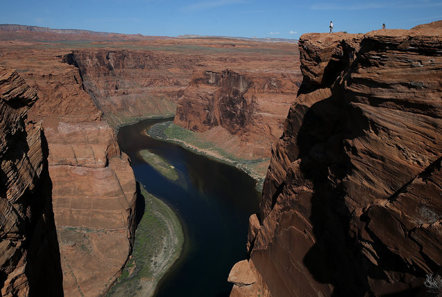 The Colorado River wraps around Horseshoe Bend on March 30, 2015 in Page, Arizona. As severe drought grips parts of the Western United States, a below average flow of water is expected to flow through the Colorado River Basin into two of its biggest reservoirs, Lake Powell and Lake Mead. Lake Powell is currently at 45 percent of capacity and is at risk of seeing its surface elevation fall below 1,075 feet above sea level by September, which would be the lowest level on record. The Colorado River Basin supplies water to 40 million people in seven western states. (Photo by Justin Sullivan/Getty Images)