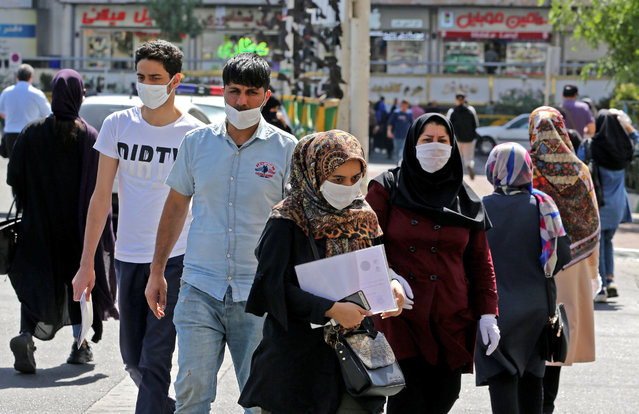 Iranians, mostly wearing face masks, are pictured in the capital Tehran on June 16, 2020 amid the coronavirus Covid-19 pandemic crisis. The Islamic republic has struggled to contain what has become the Middle East's deadliest outbreak of the COVID-19 illness since it reported its first cases in the Shiite holy city of Qom in February. (Photo by Atta Kenare/AFP Photo)