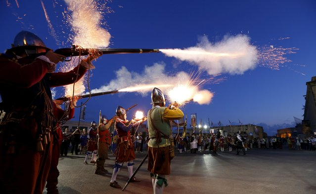 Re-enactors fire their muskets during a historical re-enactment of the inspection of Fort St. Elmo during Notte Bianca (White Night) celebrations in Valletta, Malta, October 3, 2015. (Photo by Darrin Zammit Lupi/Reuters)