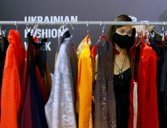 A model waits backstage at the Ukrainian Fashion Week in Kyiv, Ukraine on August 31, 2020. (Photo by Gleb Garanich/Reuters)