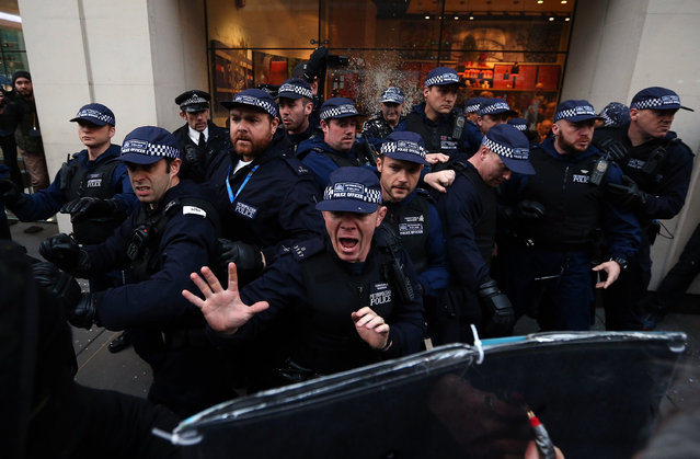 Police officers shout at protesters during a demonstration against fees and cuts in the education system on November 19, 2014 in London, England. A coalition of student groups have organised a day of nationwide protests in support of free education and to campaign against cuts. (Photo by Carl Court/Getty Images)