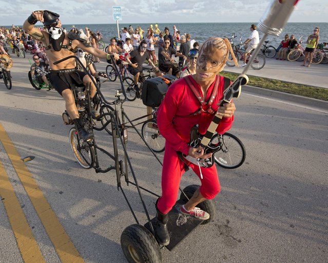 Costumed participants in the Zombie Bike Ride pedal down South Roosevelt Boulevard in Key West, Florida, October 25, 2015. (Photo by Rob O'Neal/Reuters/Florida Keys News Bureau)