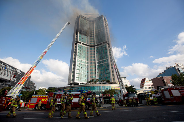 Firefighters extinguish a fire at an apartment building in Ulsan, South Korea, 09 October 2020. At least 88 residents were transported to hospital after the fire occurred around 11:07 pm the previous day. (Photo by Jeon Heon-Kyun/EPA/EFE/Rex Features/Shutterstock)