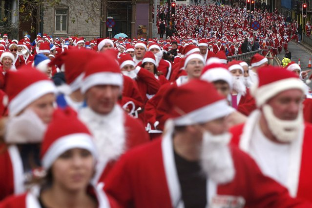 Thousands of runners dressed in Santa Claus outfits compete in the annual Santa Dash in Liverpool, northern England December 7, 2014. (Photo by Phil Noble/Reuters)