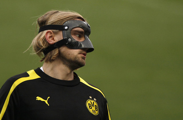 Marcel Schmelzer of German soccer team Borussia Dortmund wears a protective mask during a training session at La Rosaleda stadium in Malaga, southern Spain, on April 2, 2013. (Photo by Jon Nazca/Reuters /The Atlantic)
