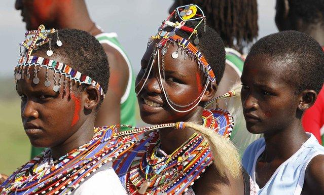 Maasai girls, dressed in their traditional wear, prepare to participate in the Maasai Olympics 2014 at the Sidai Oleng wildlife sanctuary at the base of Mt. Kilimanjaro near the Kenya-Tanzania border in Kajiado December 13, 2014. (Photo by Thomas Mukoya/Reuters)