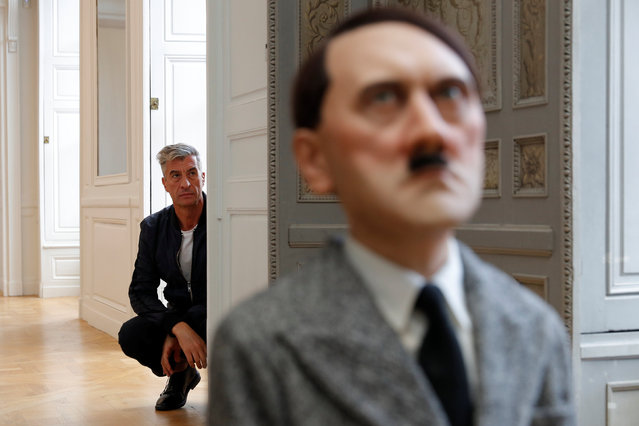"Italian artist Maurizio Cattelan poses with his creation ""Him"" (2001) prior to the opening of the exhibition ""Not Afraid of Love"" at the Hotel de la Monnaie in Paris, France, October 17, 2016. (Photo by Philippe Wojazer/Reuters)"