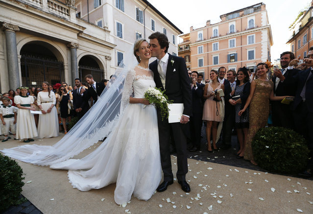 Belgium's Prince Amedeo kisses his wife Elisabetta Rosboch von Wolkenstein at the end of their wedding ceremony, at Santa Maria in Trastevere in central Rome, July 5, 2014. (Photo by Alessandro Bianchi/Reuters)