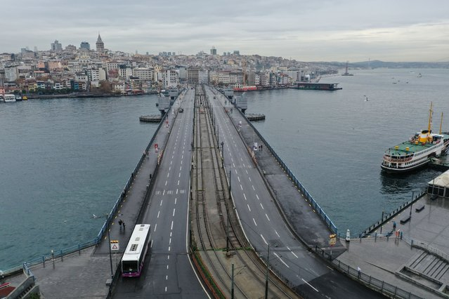 A drone photo shows empty Galata Bridge during a general curfew imposed weekend-long from Friday 9 p.m. to Monday 5 a.m. local time within new measures against a second wave of the (coronavirus) COVID-19 pandemic, in Istanbul, Turkey on December 13, 2020. (Photo by Lokman Akkaya/Anadolu Agency via Getty Images)