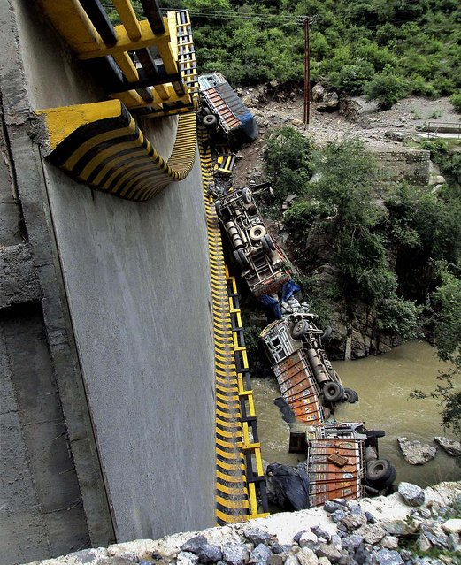 A bridge collapsed on the outskirts of the northern Indian town of Shimla. One person was killed and 2 injured in the accident, according to a news report. (Photo by Associated Press)