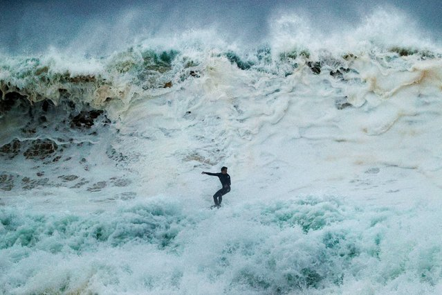 A surfer rides a wave at South Narrabeen on July 27, 2020 in Sydney, Australia. Sydney is bracing for heavy winds and large surf after over 100 millimetres of rain was recorded on Sunday. (Photo by Mark Evans/Getty Images)