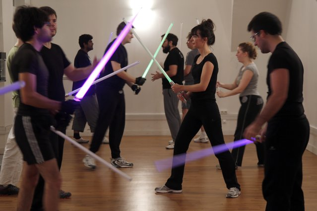 Members of the Sport Saber League practise light saber during a training session in Paris, France, November 9, 2015. (Photo by Charles Platiau/Reuters)