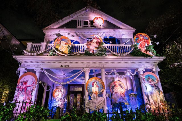 The Krewe of Muses Cosmos House is decorated with the nine Muses on January 31, 2021 in New Orleans, Louisiana. Due to the COVID-19 pandemic cancelling traditional Mardi Gras activities, New Orleanians are decorating their homes and businesses to resemble Mardi Gras floats. (Photo by Erika Goldring/Getty Images)