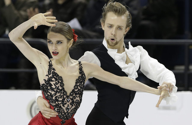 Kaitlin Hawayek, left, and Jean-Luc Baker perform during their short dance program in the U.S. Figure Skating Championships in Greensboro, N.C., Friday, January 23, 2015. (Photo by Gerry Broome/AP Photo)