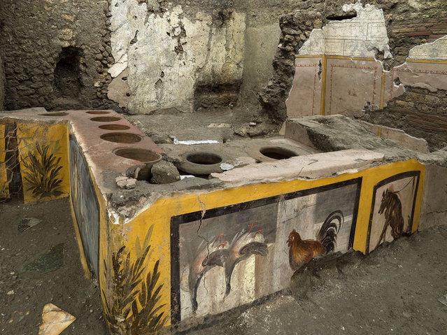An undated photo made available by the Pompeii Archeological park press office shows the thermopolium in the Pompeii archeological park, near Naples, Italy. A fast-food eatery discovered at Pompeii is now completely excavated, helping to reveal some favorite dishes of citizens of the ancient Roman city who liked to eat out.  Pompeii Archaeological Park's longtime chief, Massimo Osanna said Saturday, December 26, 2020, in a statement that while some 80 such fast-foods have been found at Pompeii, it is the first time such an eatery — known as a thermopolium since it serve hot foods — had been entirely excavated. (Photo by Luigi Spina/Parco Archeologico di Pompei via AP Photo)
