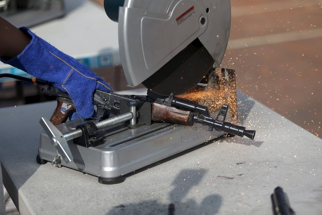 A seized weapon is destroyed by the authorities of the General Directive for the Control of Weapons and Munitions, (DIGECAM), in Guatemala City, December 17, 2015. (Photo by Jorge Dan Lopez/Reuters)