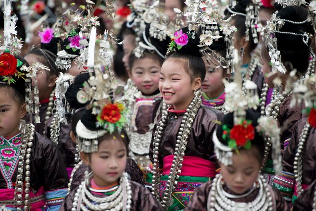 Ethnic Dong children wearing traditional costumes participate in a singing contest in Rongjiang, Guizhou province, December 18, 2015. (Photo by Reuters/Stringer)
