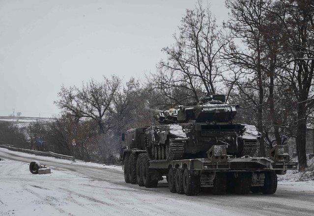 A military truck transports a tank near Debaltseve, eastern Ukraine, February 10, 2015. (Photo by Gleb Garanich/Reuters)
