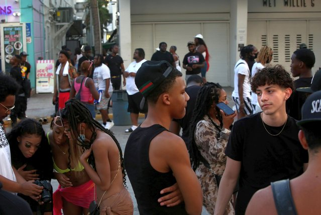 People congregate in front of the bars and restaurants on South Beach during Spring Break, amid the coronavirus disease (COVID-19) pandemic, in Miami, Florida, U.S., March 27, 2021. (Photo by Yana Paskova/Reuters)