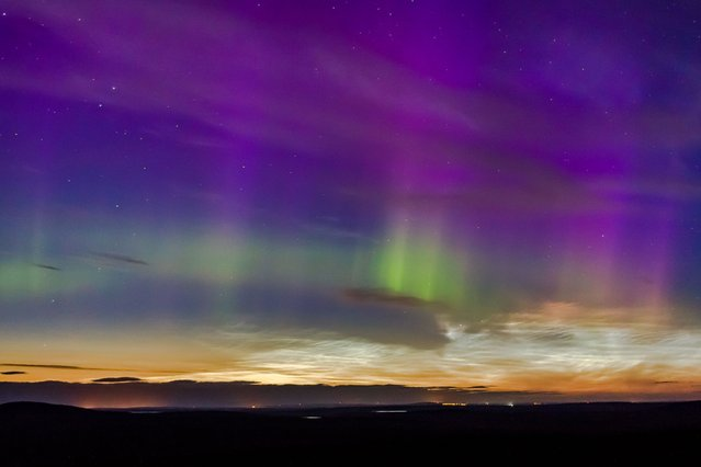 Amazing display of Noctilucent clouds and Northern lights above Caithness, Scotland, on August 20, 2013. (Photo by Guzelian)