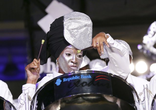 "A member of the Republic Bank Exodus steelband plays ""De Puna Band"" in the large band category during the National Panorama finals held by the governing body Pan Trinbago at the Queen's Park Savannah in Port-of-Spain February 15, 2015. (Photo by Andrea De Silva/Reuters)"