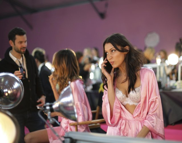 Model Bella Hadid gives a phone call backstage before the Victoria's Secret fashion show in Paris, France, Wednesday, November 30, 2016. (Photo by Thibault Camus/AP Photo)