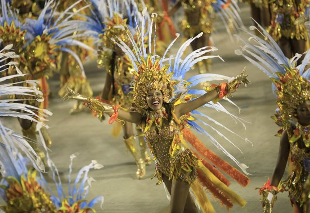 Revelers from the Portela samba school participate in the annual carnival parade in Rio de Janeiro's Sambadrome, February 16, 2015. (Photo by Ricardo Moraes/Reuters)