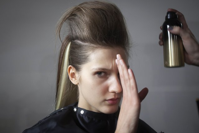 A model prevents hairspray from being sprayed into her eyes backstage before The Blonds 2015 collection show during New York Fashion Week in the Manhattan borough of New York February 18, 2015. (Photo by Carlo Allegri/Reuters)