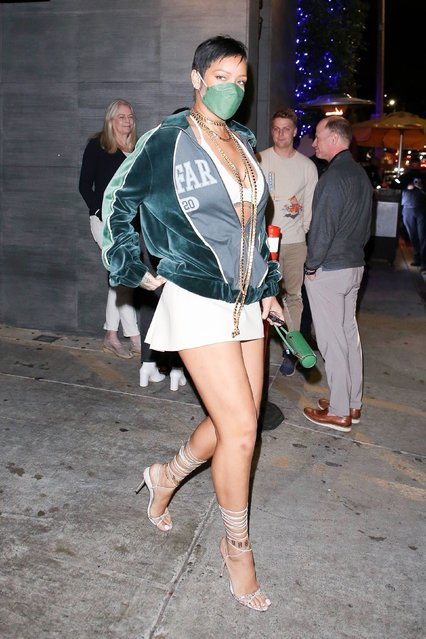 Rihanna brings her memorable and nostalgic 2012 style back as she rocks a bold pixie cut to dinner at Nobu in West Hollywood on May 18, 2021. (Photo by Backgrid USA)