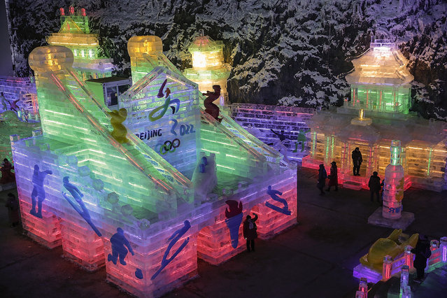 Visitors view ice sculptures at Yanqing Ice Festival on January 19, 2016 in Beijing, China. Chinese cities Beijing and Zhangjiakou won the bid to host the 2022 Winter Olympic Games on July 31,  2015 in Kuala Lumpur. (Photo by Lintao Zhang/Getty Images)