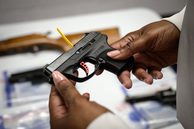 """A Ruger pistol, or handgun, is displayed during a gun """"buyback"""" event held by the New York Police Department (NYPD) and the office of the Attorney General, in the New York borough of Brooklyn on May 22, 2021. The """"no questions asked"""" buyback event offers a chance for gun owners to trade in firearms for gift cards and iPads, as part of ongoing efforts by the NYPD to tackle gun crime. (Photo by Ed Jones/AFP Photo)"""