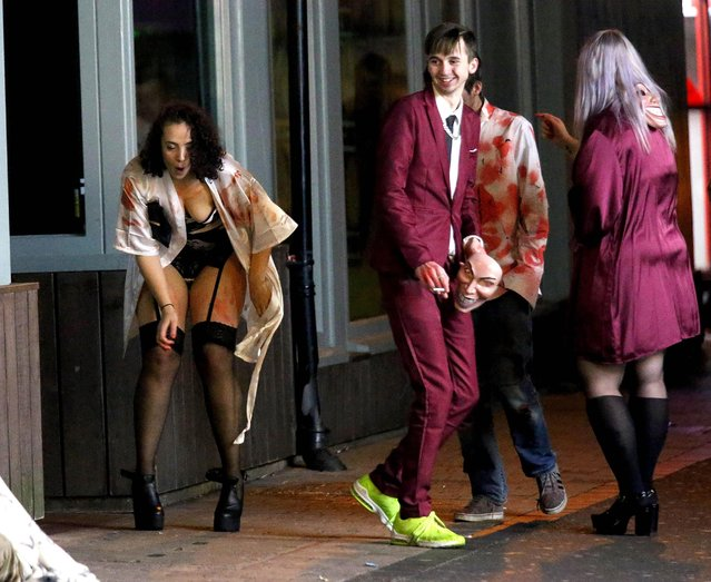 It's all fun and games on the streets of Blackpool, England durind Halloween night on Saturday, October 27, 2018. Friends posed for spooky snaps in Blackpool, Portsmouth, Birmingham and Manchester as others seemed to be caught looking worse for wear. (Photo by NB Press LTD)