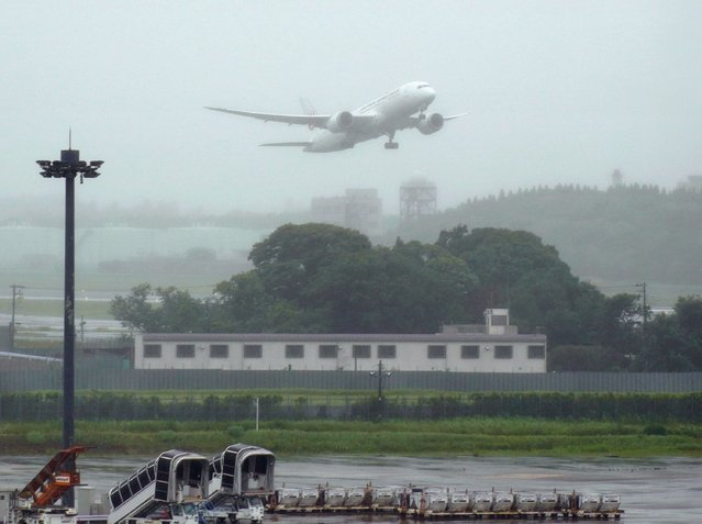 A plane carrying the vaccine cargo donated by Japanese government, takes off Narita International Airport in Narita, east of Tokyo, Friday, June 4, 2021.  Japan is donating 1.24 million doses of AstraZeneca vaccine to Taiwan to help the island fight its latest resurgence of the COVID-19 cases, as Tokyo, despite its painfully slow vaccine rollouts at home, tries to play a greater role in global vaccination distribution. (Photo by Kyodo News via AP Photo)