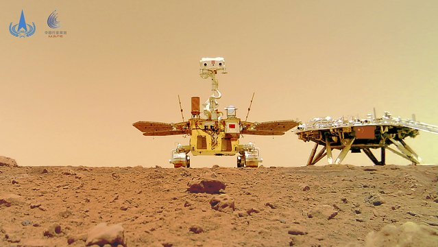 In this image released by the China National Space Administration (CNSA) on Friday, June 11, 2021, the Chinese Mars rover Zhurong is seen near its landing platform taken by a remote camera that was dropped into position by the rover. China on Friday released a series of photos taken by its Zhurong rover on the surface of Mars, including one of the rover itself taken by a remote camera. (Photo by CNSA via AP Photo)