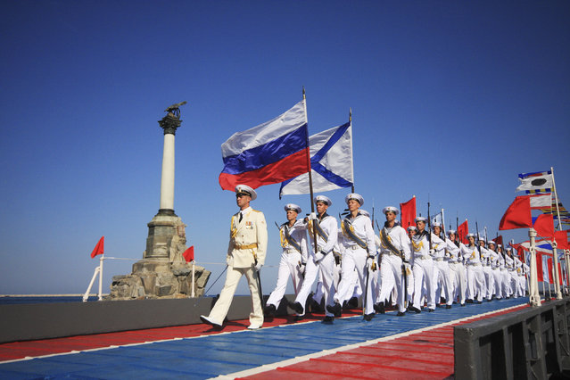 Russian sailors march during celebrations to mark Navy Day in the port of Sevastopol July 27, 2014. (Photo by Reuters/Stringer)