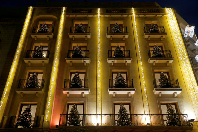 Christmas trees decorate a building in downtown Beirut, Lebanon December 17, 2016. (Photo by Mohamed Azakir/Reuters)
