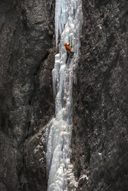 A climber ascends Spada nella Roccia in Serrai di Sottoguda in the Italian Dolomites. Back in the 80s this represented a breakthrough in ice climbing and was considered one of the hardest routes in the world. (Photo by James Rushforth/Caters News)