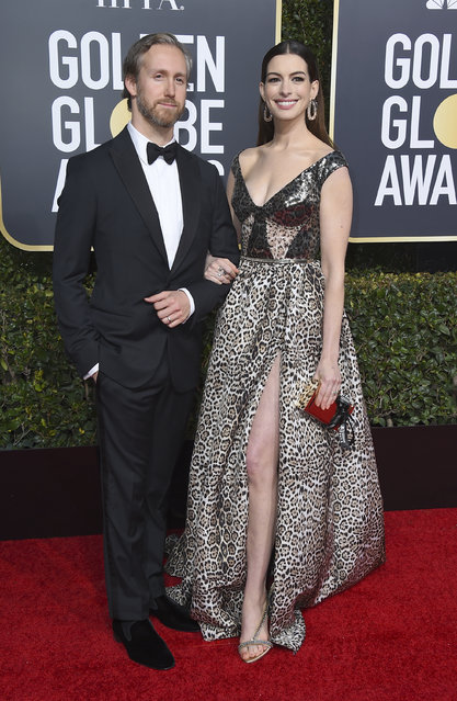 Anne Hathaway, right, and Adam Shulman arrive at the 76th annual Golden Globe Awards at the Beverly Hilton Hotel on Sunday, January 6, 2019, in Beverly Hills, Calif. (Photo by Jordan Strauss/Invision/AP Photo)