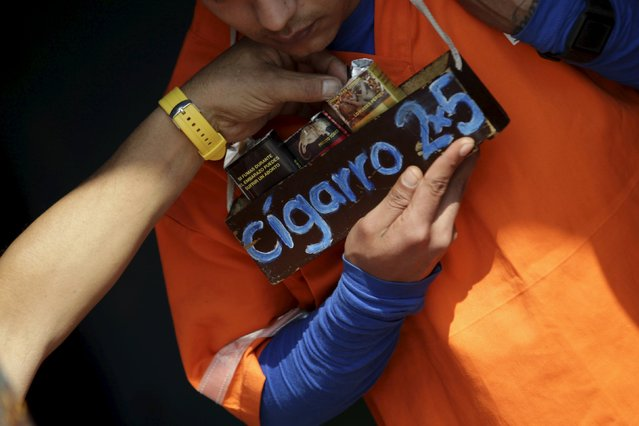 An inmate sells cigarettes in the Topo Chico prison, during a media tour, in Monterrey, Mexico, February 17, 2016. (Photo by Daniel Becerril/Reuters)