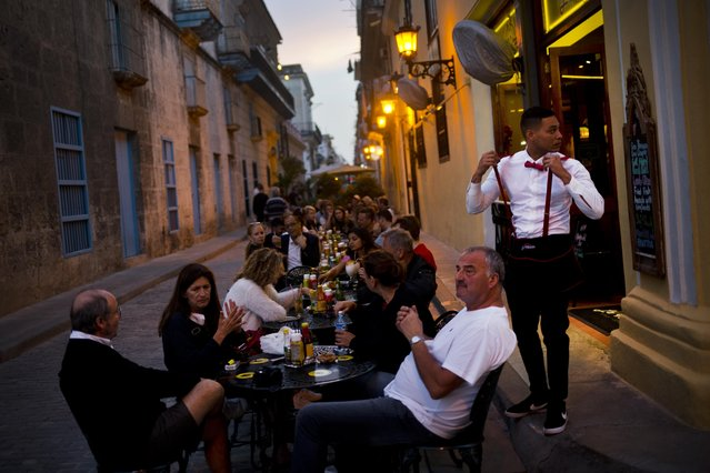 In this January 31, 2018 file photo, patrons fill the outdoor seating area of a private restaurant in Havana, Cuba. Cuba's government modified in December 2018 a series of measures unpopular with the country's private sector, including lifting restrictions on the number of business permits a person can have and the number of chairs there can be in restaurants. (Photo by Ramon Espinosa/AP Photo)