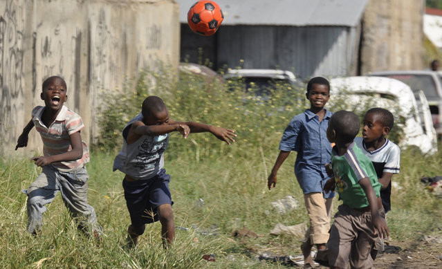 Mozambican youth play soccer in a suburb in Maputo, Mozambique, May 16, 2010. (Photo by Grant Lee Neuenburg/Reuters)