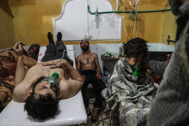"Photo of the year nominee: victims of an alleged gas attack receive treatment in eastern Ghouta, by Mohammed Badra. People receive treatment after a suspected chemical attack on al-Shifunieh village, in eastern Ghouta, Syria. Also nominated in the ""spot news"" story category: Syria, No Exit. (Photo by Mohammed Badra/EPA/World Press Photo 2019)"