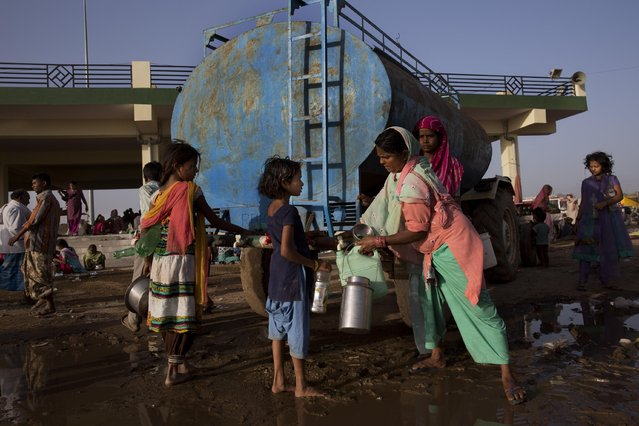 Indian Sufi Muslim devotees collect drinking water from a tanker at a makeshift camp during the Urs Festival in Ajmer, in the western Indian state of Rajasthan, India, Saturday, April 25, 2015. (Photo by Bernat Armangue/AP Photo)