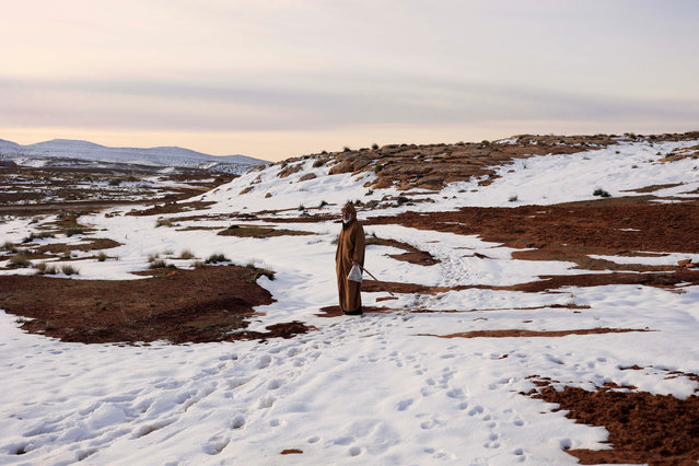 Hamza, 59, a mountaineer is seen near his house on the outskirts of Al Bayadh in the high steppe region of south western Algeria January 26, 2017. In a special weather bulletin, Algeria's National Meteorological Office since mid-January has been announcing heavy rains for central and eastern cities, and snowstorms for mountainous regions that have cut off roads and isolated homes in remote rural areas. (Photo by Zohra Bensemra/Reuters)