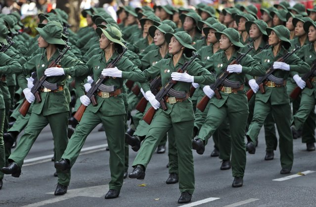 """Military personnel march during a parade celebrating the 40th anniversary of the end of the Vietnam War which is also remembered as the """"Fall of Saigon"""", in Ho Chi Minh City, Vietnam, Thursday, April 30, 2015. (Photo by Dita Alangkara/AP Photo)"""