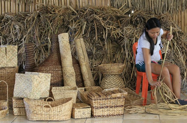 A woman makes handcrafts for export in Las Pinas, south of Manila, Philippines March 10, 2016. (Photo by Romeo Ranoco/Reuters)