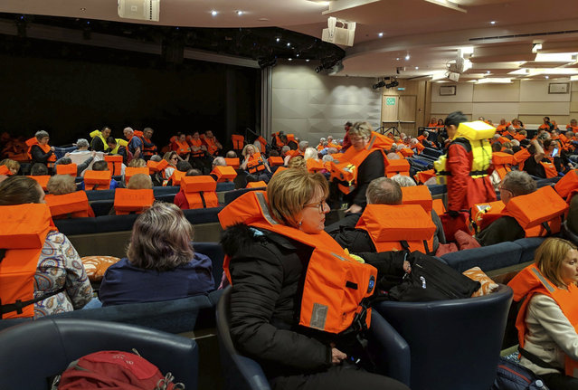 This photo provided by Michal Stewart shows passengers on board the Viking Sky, waiting to be evacuated, off the coast of Norway on Saturday, March 23, 2019. Rescue workers off Norway's western coast rushed to evacuate 1,300 passengers and crew from the disabled cruise ship by helicopter on Saturday, winching them one-by-one to safety as heaving waves tossed the ship from side to side and high winds battered the operation. (Photo by Michal Stewart via AP Photo)