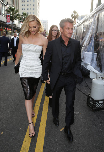 """Charlize Theron and Sean Penn seen at the Warner Bros. premiere of """"Mad Max: Fury Road"""" on Thursday, May 7, 2015, in Los Angeles. (Photo by Eric Charbonneau/Invision for Warner Bros./AP Images)"""