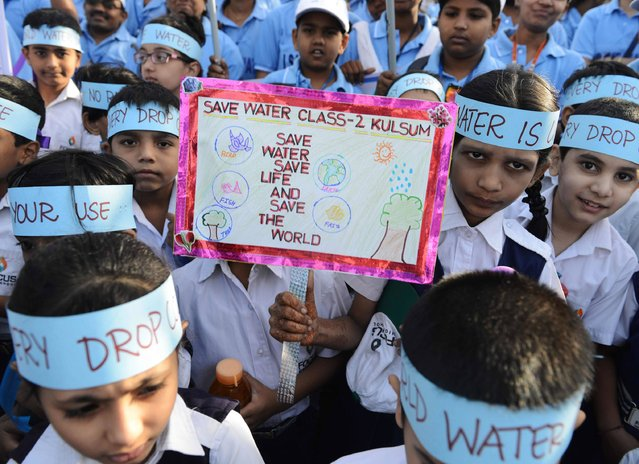 Indian school children take part in an awareness rally held to mark World Water Day in Hyderabad on March 22, 2016. The United Nations World Water Day is marked anually on March 22 and in 2016 focuses on the positive impact water quantity and quality can have on workers' lives and livelihoods, and societies and economies. (Photo by Noah Seelam/AFP Photo)